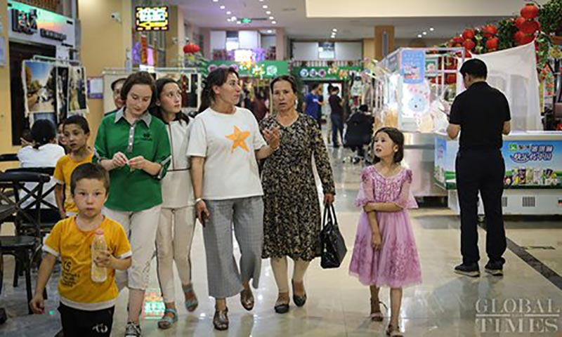 Locals enjoy their after-work time at Hotan night market in China's Xinjiang Uyghur Autonomous Region