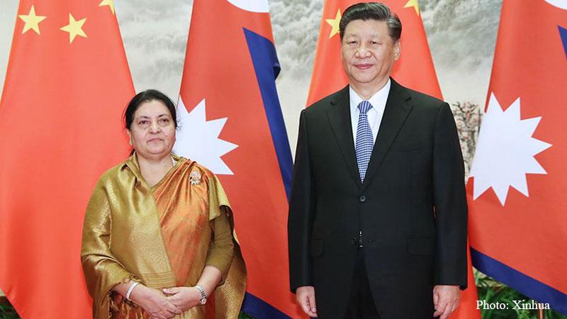 Chinese President Xi speaks with President Bhandari