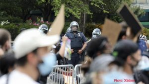 Why are Chinese partaking in 'revenge observation' on US riots?