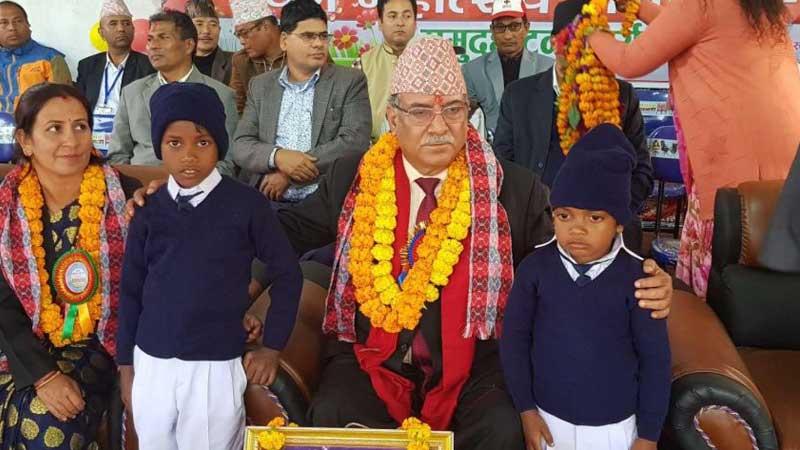 Chairman Prachanda with adopted children Arun Majhi and Patrush Musahar